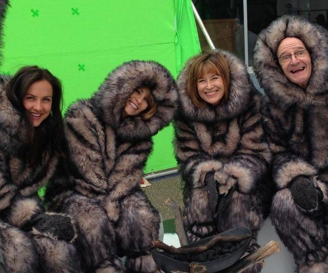 Keeping cosy in between filming has never looked so cute.