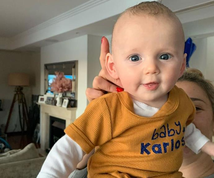 """Proud dad Karl shared this heart-melting new snap of three-month-old Harper rocking a """"baby Karlos"""" onesie, joking her transformation into his mini-me was """"taking shape."""""""