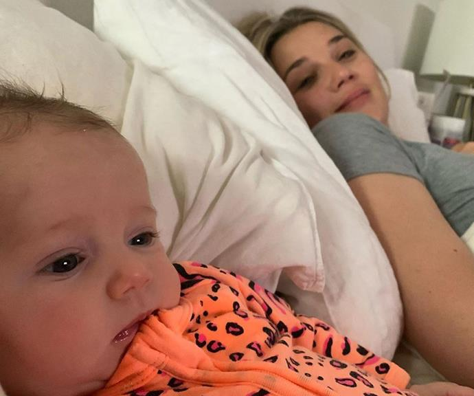 """""""I get out of bed for one minute. One little minute and my side is gone,"""" Karl quipped alongside this touching snap of Harper and Jasmine cuddling in bed."""