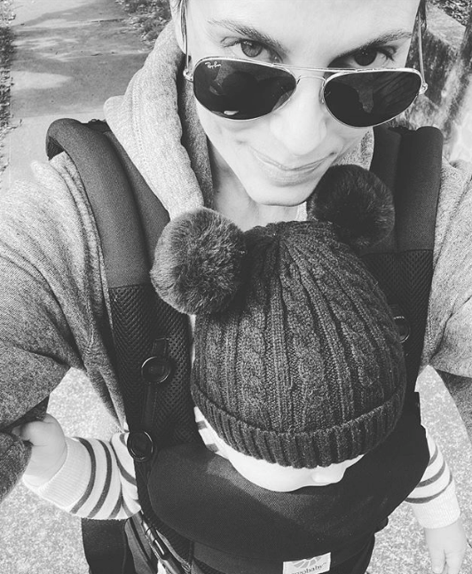 """Zoe also popped up a rare pic of her new baby son while out strolling in July: """"Two pom poms are better than one,"""" she quipped at the time."""