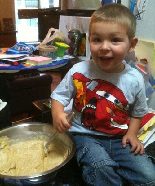 He was so excited to be making cupcakes for his birthday Image: Supplied