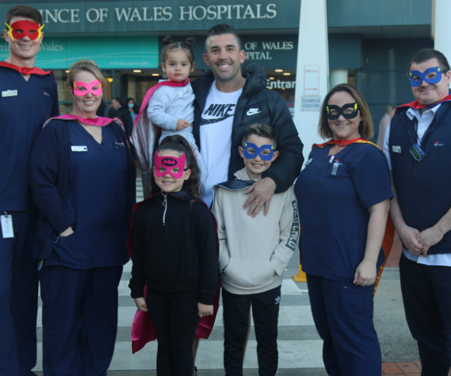 Braith and his kids with the heroes who work at the Prince of Wales Hospital.