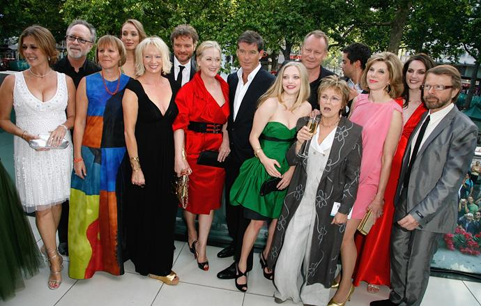 Julie (glass of wine in hand) with the cast and crew of *Mammia Mia! The Movie* at the premiere of the film in 2008. Her co-stars included Meryl Streep, Christine Baranski, Amanda Seyfried, Colin Firth, Stellan Skarsgard and Pierce Brosnan.