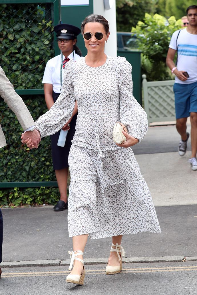 Pregnant Pippa backed up her straight-ace Wimbledon appearances in 2018 in this gorgeous floral smock dress.