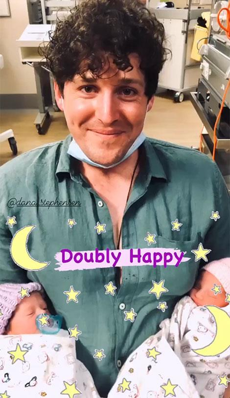 He's got his hands full! Proud new dad Lachy with Lulu and Lottie.