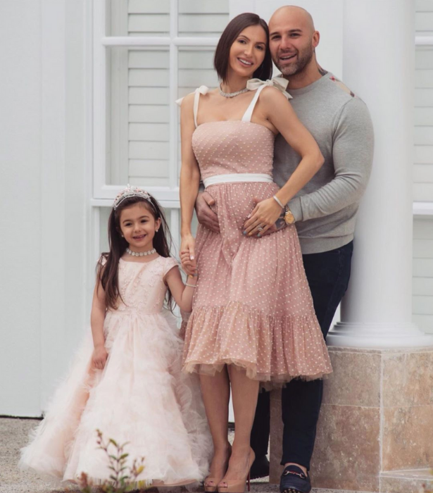 Maria and Carlos announced their pregnancy with this adorable family photo.