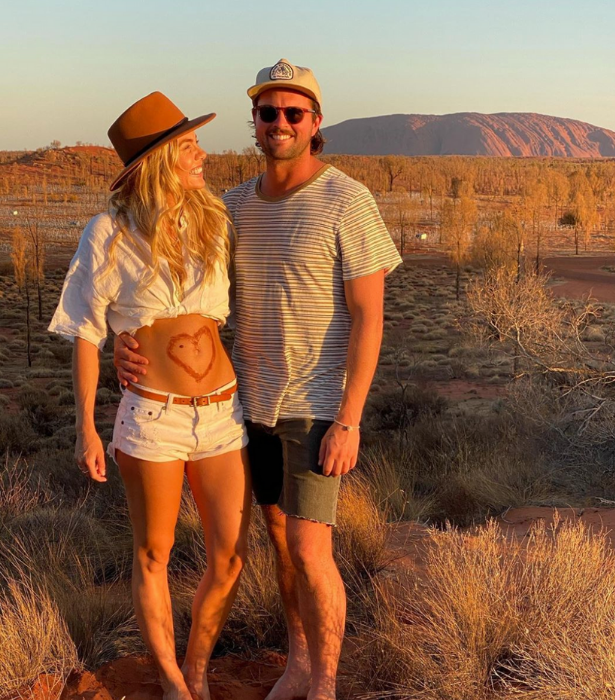 Elyse and Josh announced the news with these sweet and scenic photos.