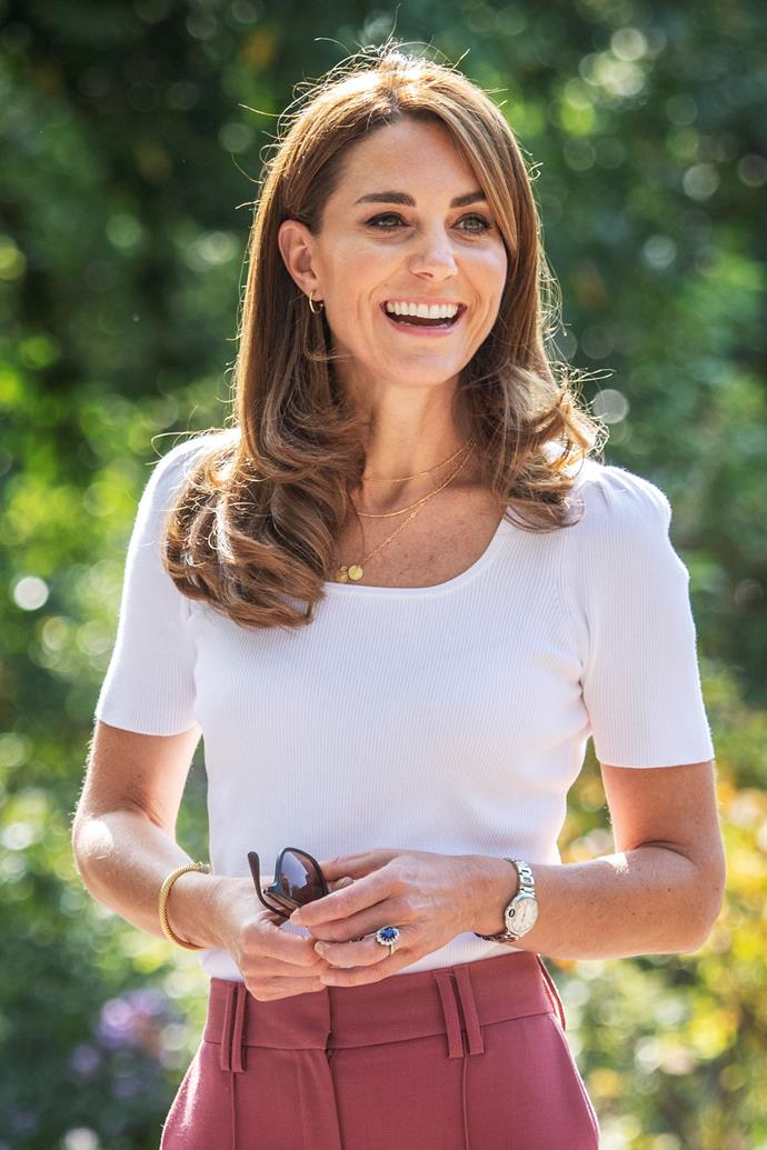 Kate Middleton looked radiant as she met with several parents in London's Battersea Park on Tuesday.