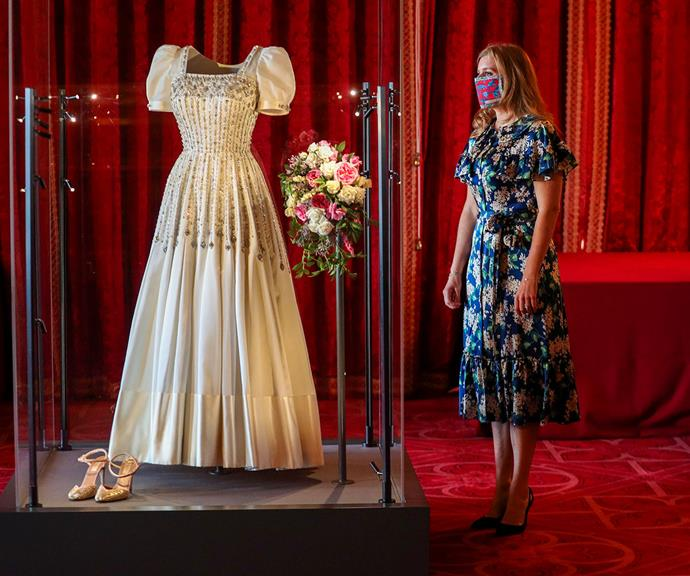 Princess Beatrice takes a moment to marvel at her wedding dress.