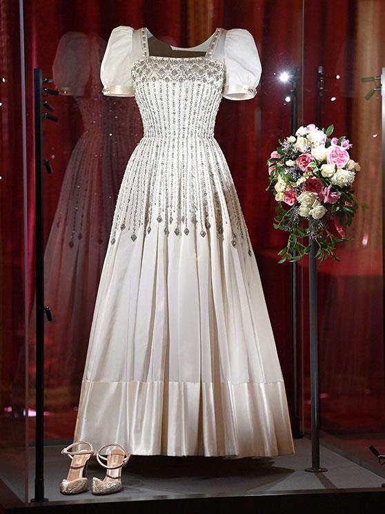 Fit for a princess: Beatrice borrowed this stunning design from her grandmother and had it remodelled and fitted by one of the Queen's favourite designers, Angela Kelly as well as Stewart Parvin.