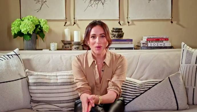 Meghan looked chic as ever in the new clip.