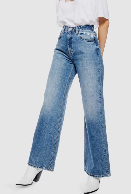"""TopShop have been killing the jeans game for donkey's years, so when they released this 80s-esque style, we were, of course, sold. $50.97, **[buy them online via The Iconic here](https://www.theiconic.com.au/slim-wide-leg-jeans-1075139.html
