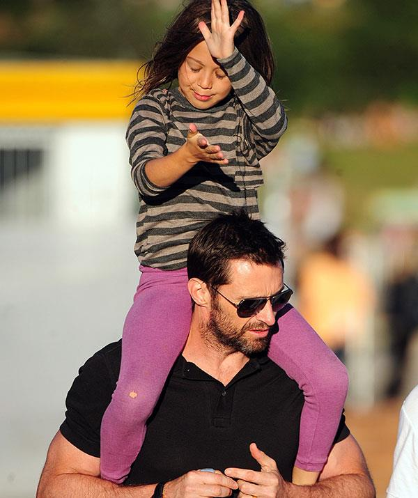Nothing beats a ride on dad's shoulders! Hugh carries around Ava during an outing to Sydney's Bondi Beach in 2012.