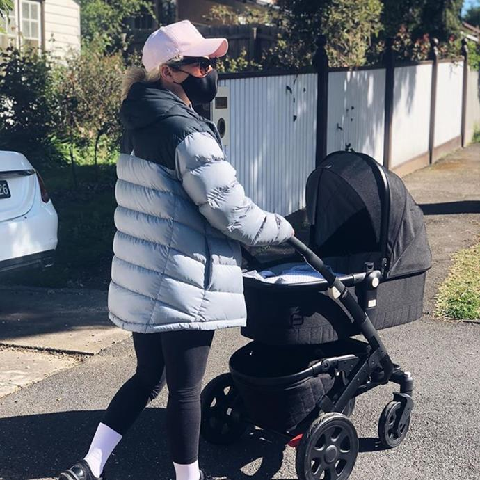 Ash enjoying a walk in the sunshine with her tiny tot.