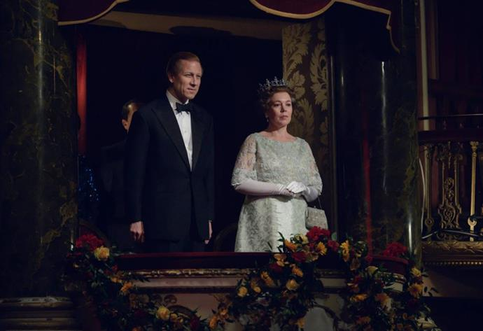 The Queen and Prince Philip, played by Olivia Colman and Tobias Menzies respectively, look on from the coveted royal box during a performance.