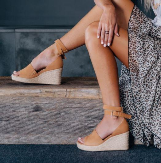 """FRANKiE4's heeled espadrille wedges are also all kinds of comfy and chic. $259.95, **[buy them online here](https://frankie4.com/collections/heels-1/products/nadia-tan-nubuck?variant=30103012835441