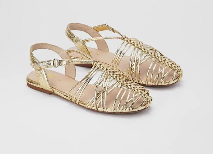 """Zara's metallic flat sandals also add a touch of pizzaz to any outfit. $52.95, **[buy them online here](https://www.zara.com/au/en/cage-sandals-p12508530.html?v1=53083750&v2=1278333