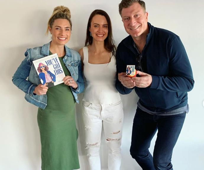 And pop! Lauren's bump has well and truly nipped out. The famous couple pose with good friend and their PR agent, Bec Brown, ahead of her book launch.