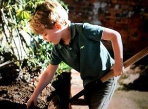 Prince George (snapped here by mum Kate) gets his hands dirty in the garden.