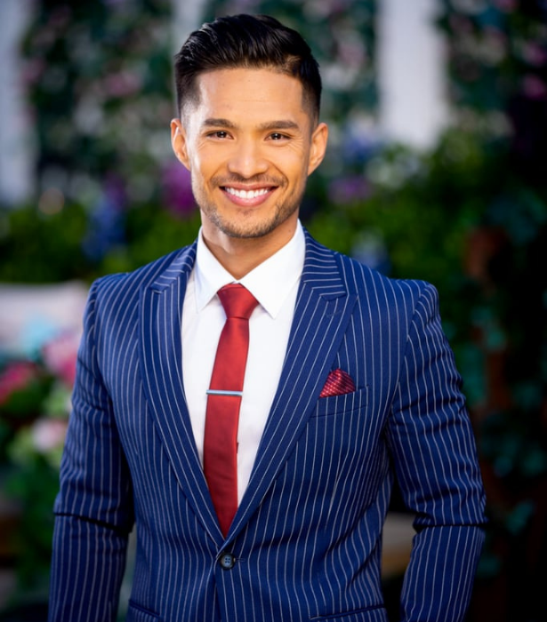 """**Saj, 25, SA** <br><br> With his big smile and the mysterious looking red gift he can be seen sporting on the red carpet, Saj looks like a sweetheart. <br><br> Hailing from Afghanistan, the personal trainer is multilingual and hopes to impress our ladies with the language of love. As for what turns him on most when persuing a woman? """"Their energy, how they treat others and their passion for their goal."""""""