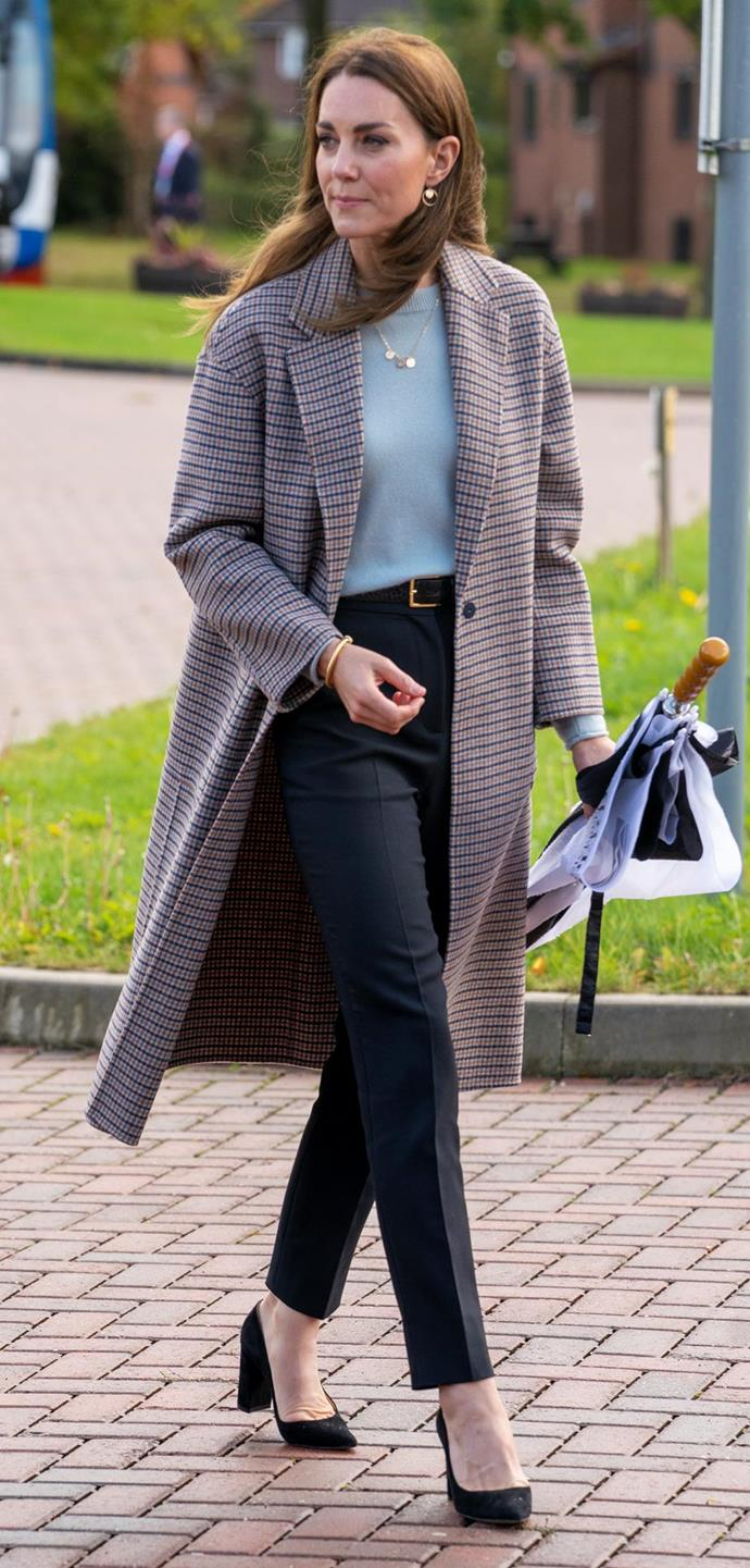 Kate looked ultra chic on Tuesday in a Massimo Dutti checkered coat.
