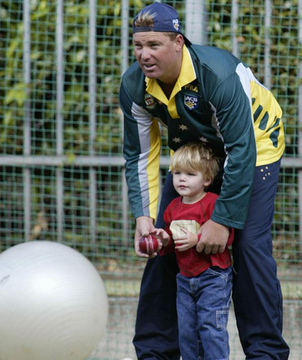 Close from the get-go: A young Jackson accompanies his dad Shane Warne during a training session at the Melbourne Cricket Ground in December 2001.