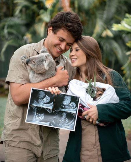 "They shared a sweet candid snap in September with a very appropriate analogy - ""The animal joeys we care for are excited to meet our human joey. Baby Wildlife Warrior is about the size of a hummingbird now!"""