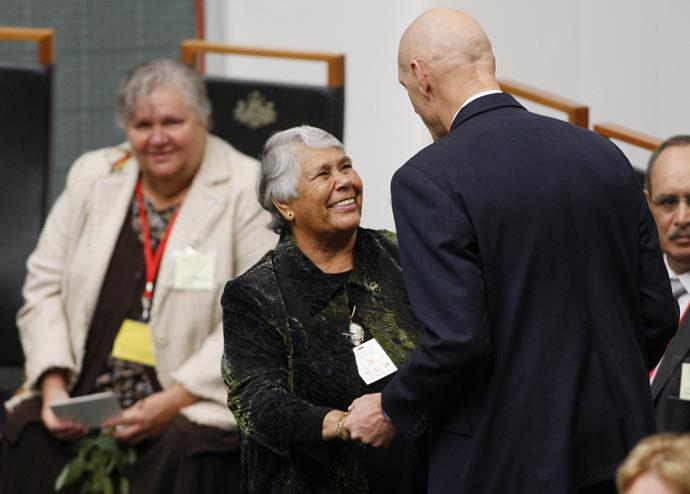 Lowitja is greeted by Peter Garret inside Parliament House ahead of a historic apology speech by then Prime Minister Kevin Rudd in 2008.