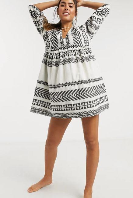"""Accessorize's mini smock beach dress is also perfect for those lazy seaside days leading into a dusk BBQ. $80, **[buy it online via ASOS here](https://www.asos.com/au/accessorize/accessorize-mini-smock-beach-dress-in-white-and-black-aztec-pattern/prd/14415462