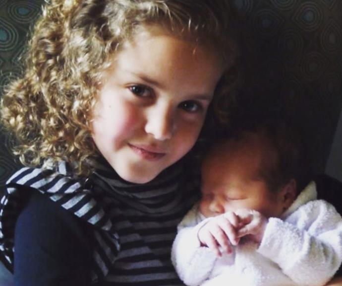 Proud big sister Zipporah couldn't be a more loving older sister.