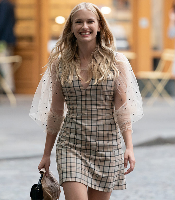 Camille's most iconic look has to be this See by Chloe plaid dress, perfectly layered with a sheer blouse featuring statement sleeve.