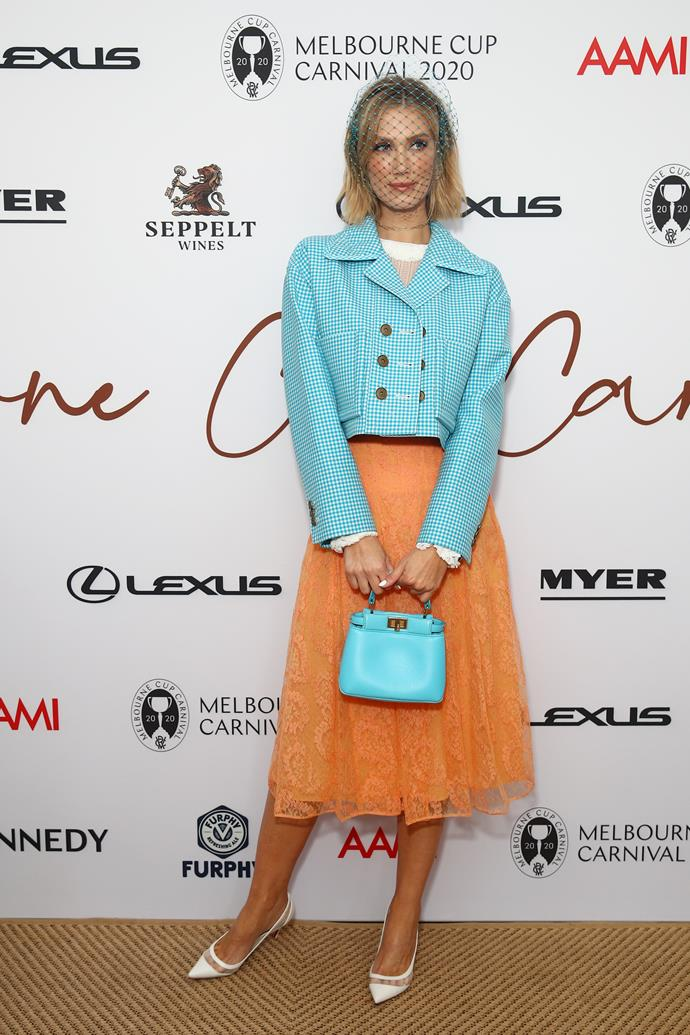 Delta Goodream embraced a bit of 60s-esque chic in a boxy jacket and midi skirt combo.