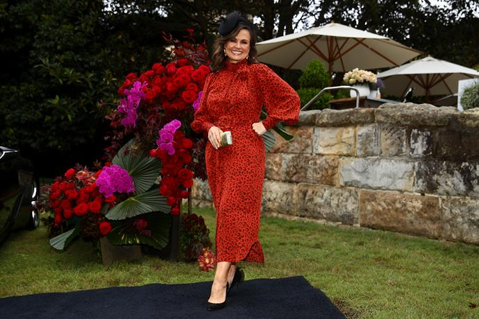 """Lisa Wilkinson also looked stunning in a [bright red printed frock](https://www.nowtolove.com.au/fashion/fashion-news/lisa-wilkinson-the-project-outfits-55928