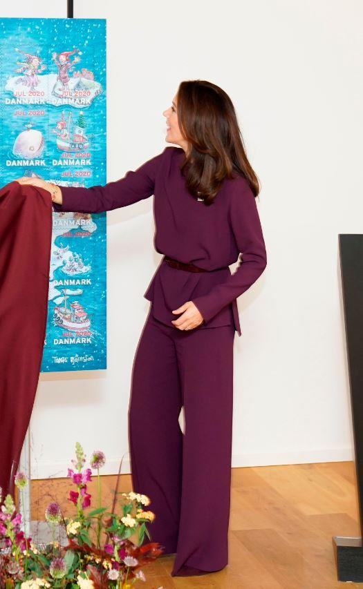 The Crown Princess looked chic in a full purple ensemble for the unveiling of the annual Christmas stamp.