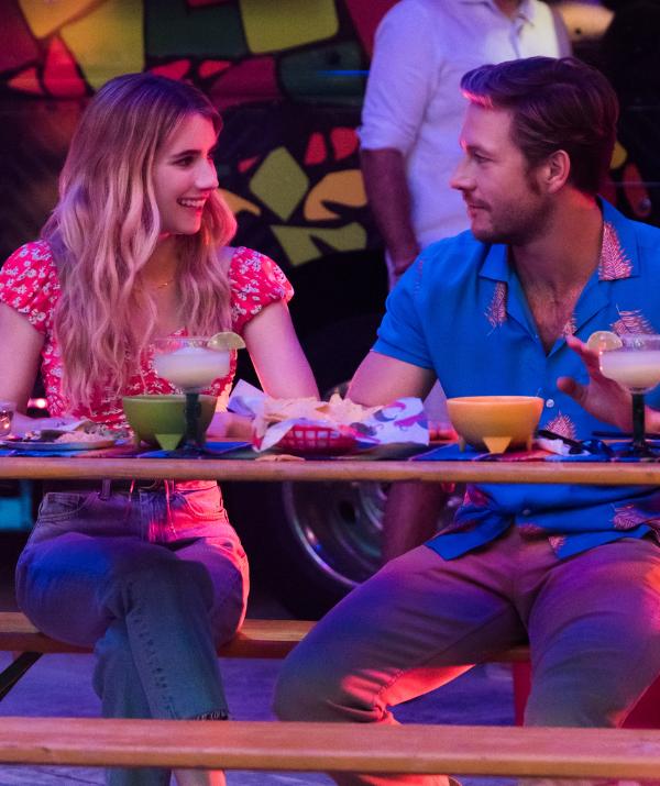 The Australian actor currently stars in Netflix's new rom-com *Holidate* alongside Emma Roberts.