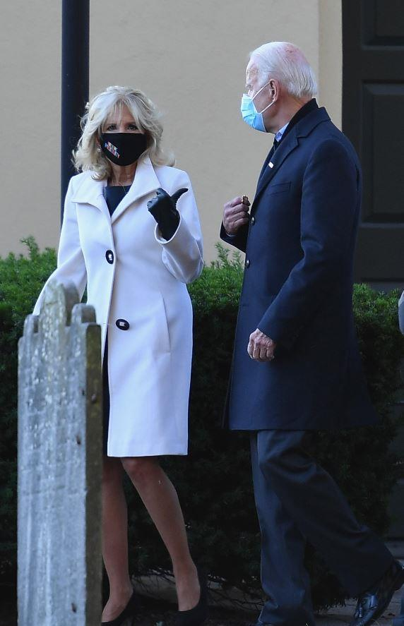 From the very beginning, she and her husband have set an example in wearing face masks where necessary as they delved into the campaign trail. Jill's chic white coat here, which she was seen wearing on election day 2020 was also a sight to behold.