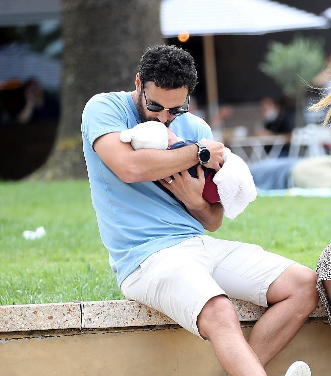 Cam is the ultimate doting dad.