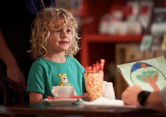 The curly haired kid is full of beans usually, with plenty of sweet anecdotes and gestures towards his parents.