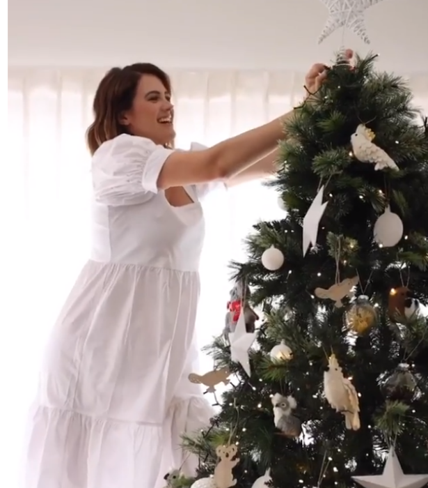The model mum's bump was hard to spot even as she dressed her Christmas tree.