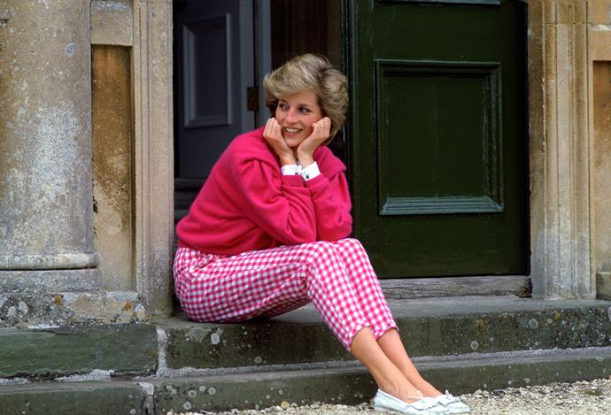 One of Diana's most iconic portraits features her sitting happily on a step outside Highgrove Estate in this oh-so-80s ensemble consisting pink gingham pants and a pink sweater.