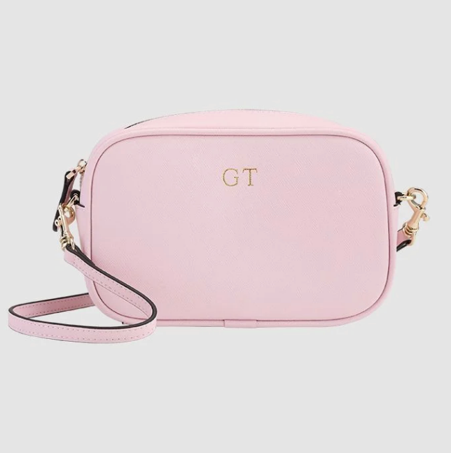 """Not only are The Daily Edited bags simple and stylish, they also have a personal touch. You can get yours (or your giftee's) initials engraved on any of their products - and frankly, we're obsessed. $99.95, **[buy it online here](https://www.thedailyedited.com/pastel-pink-mini-cross-body-bag?_store=au