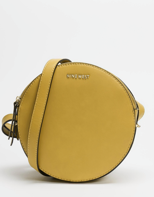 """Nine West also have the right idea with this circular mini crossbody bag - perfect for a night out or just a wander to the shops. $99.95, **[buy it online via The Iconic here](https://www.theiconic.com.au/round-about-cross-body-1153734.html