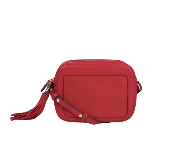 """Designer label The Horse is a go-to for any handbag lover, and this bright red creation is case in point as to why. $119, **[buy it online here](https://www.thehorse.com.au/products/double-zip-cross-body-bag-vintage-red