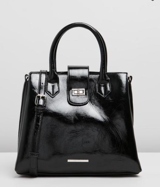 """If you're after the Queen's go-to patent leather style, look no further than trusty accessory label Tony Bianco. A perfectly sized day bag, this design will take you anywhere and everywhere. $119.95, **[buy it online via The Iconic here](https://www.theiconic.com.au/marlo-1099271.html