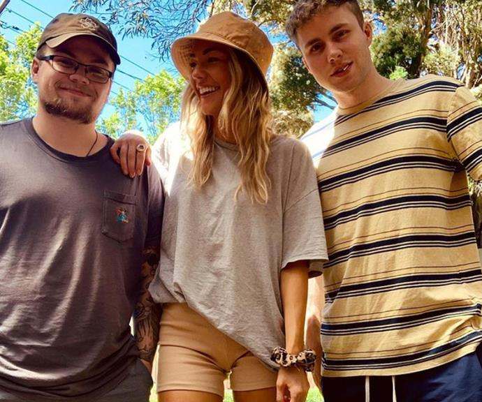 A beaming Sam with her brothers Josh and Alex.