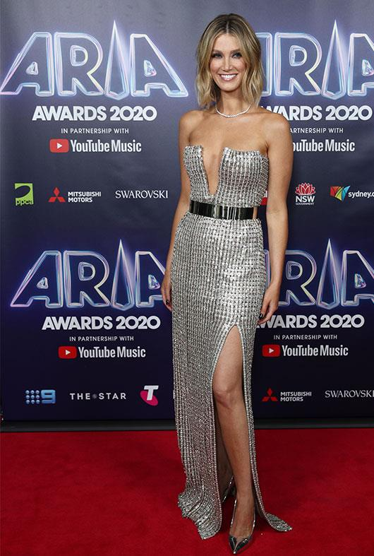 The singer oozed elegance in this metallic silver J'Aton Couture gown for the event.