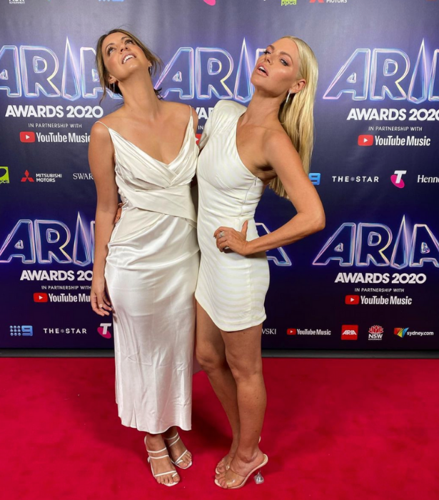 """**Brooke Boney & Sophie Monk**<br><br>  The *Today Show* presenter and former Bachelorette showed us all how to pull of the """"year 10 formal"""" pose."""