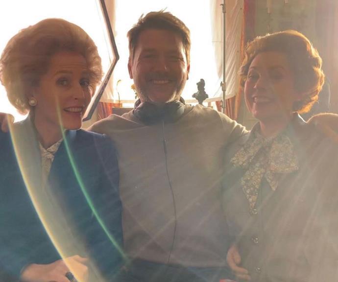 Gillian Anderson, director Benjamin Caron and Olivia Colman share a warm embrace.