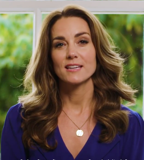 A glowing and radiant Kate wore a beautiful gold necklace in the video.