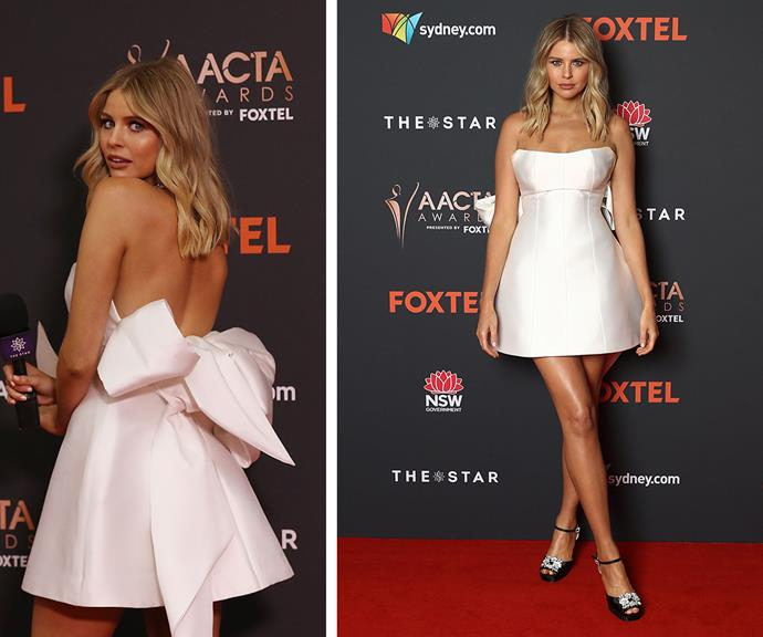 Presenter Tegan Martin adds a very punchy touch of pizazz at the back of her strapless white gown with an oversized bow detail.
